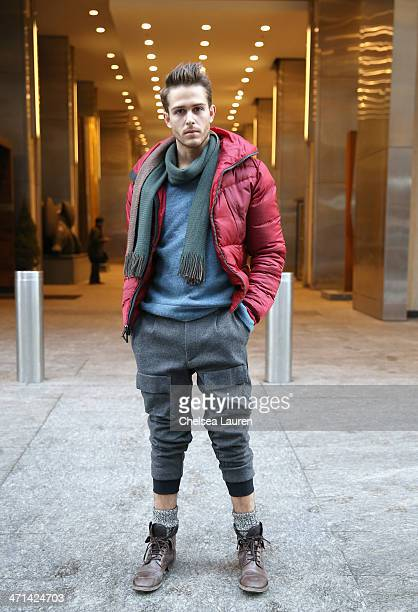 Adam Gallagher menswear blogger of iamgallacom seen wearing a red jacket blue sweater and pants by Black Sail by Nautica Fall 2014 with his own scarf...