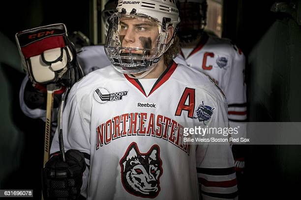 Adam Gaudette of Northeastern University exits the tunnel before a Frozen Fenway game against University of New Hampshire at Fenway Park on January...