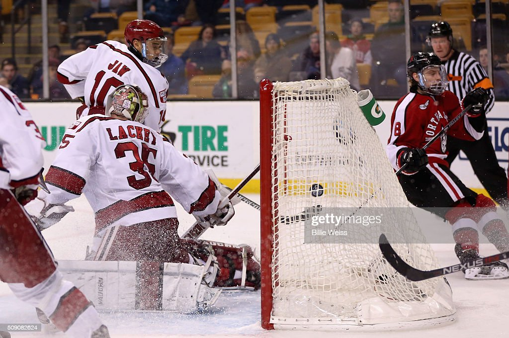 Adam Gaudette #8 of Northeastern University scores a goal against Harvard University during the third period of the Beanpot Tournament consolation game at TD Garden on February 8, 2016 in Boston, Massachusetts.