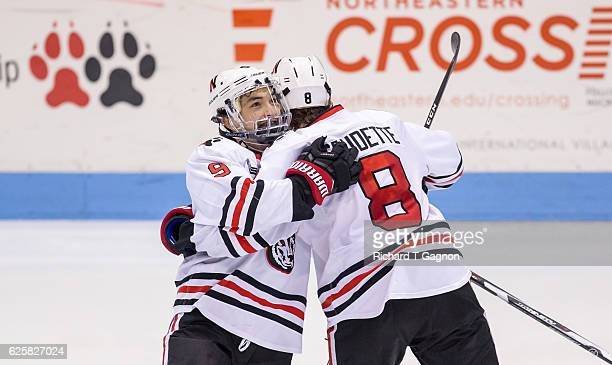 Adam Gaudette of the Northeastern Huskies celebrates his goal against the Minnesota Golden Gophers with teammate Dylan Sikura during NCAA hockey at...