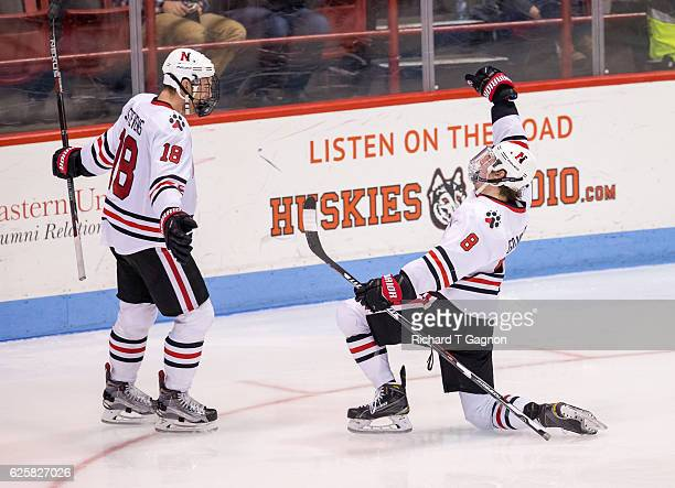 Adam Gaudette of the Northeastern Huskies celebrates his goal against the Minnesota Golden Gophers with his teammate John Stevens during NCAA hockey...