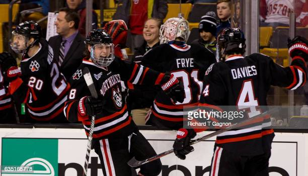 Adam Gaudette of the Northeastern Huskies celebrates his goal against the Boston College Eagles with teammate Jeremy Davies during NCAA hockey in the...