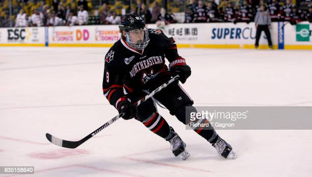Adam Gaudette of the Northeastern Huskies skates against the Boston College Eagles during NCAA hockey in the consolation game of the annual Beanpot...