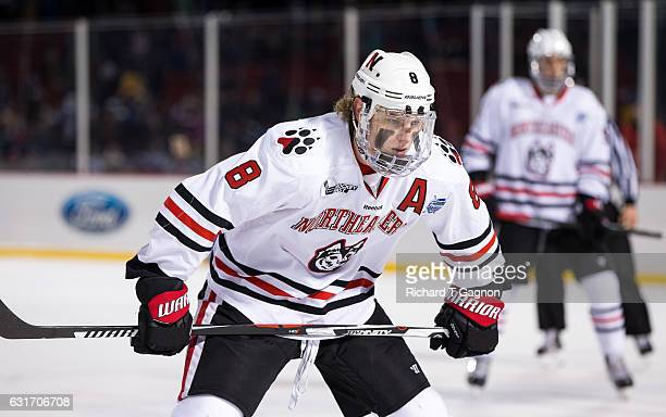 Adam Gaudette of the Northeastern Huskies skates against the Northeastern Huskies during NCAA hockey at Fenway Park during 'Frozen Fenway' on January...