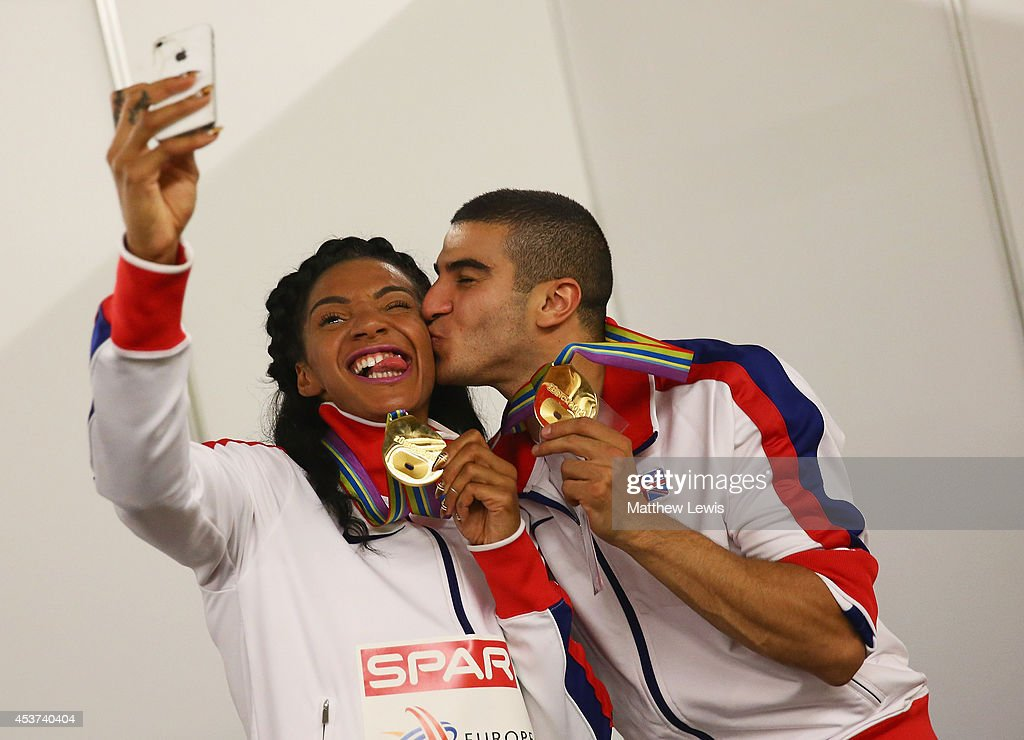 Adam Gemili andAshleigh Nelson of Great Britain take a selfie after winning Gold in the Mens and Womens 4x100m relay during day six of the 22nd...