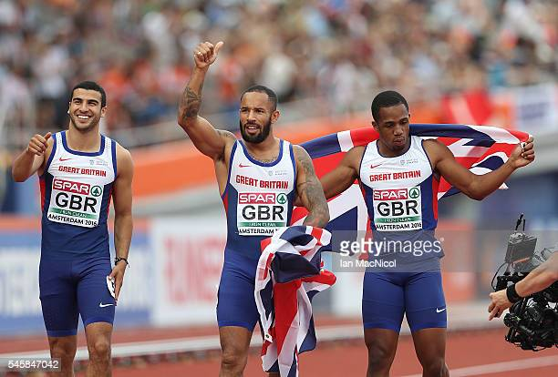 Adam Gemili James Ellington and Chijindu Ujah of Great Britain celebrate after winning gold in the final of the mens 4x100m relay on day five of The...