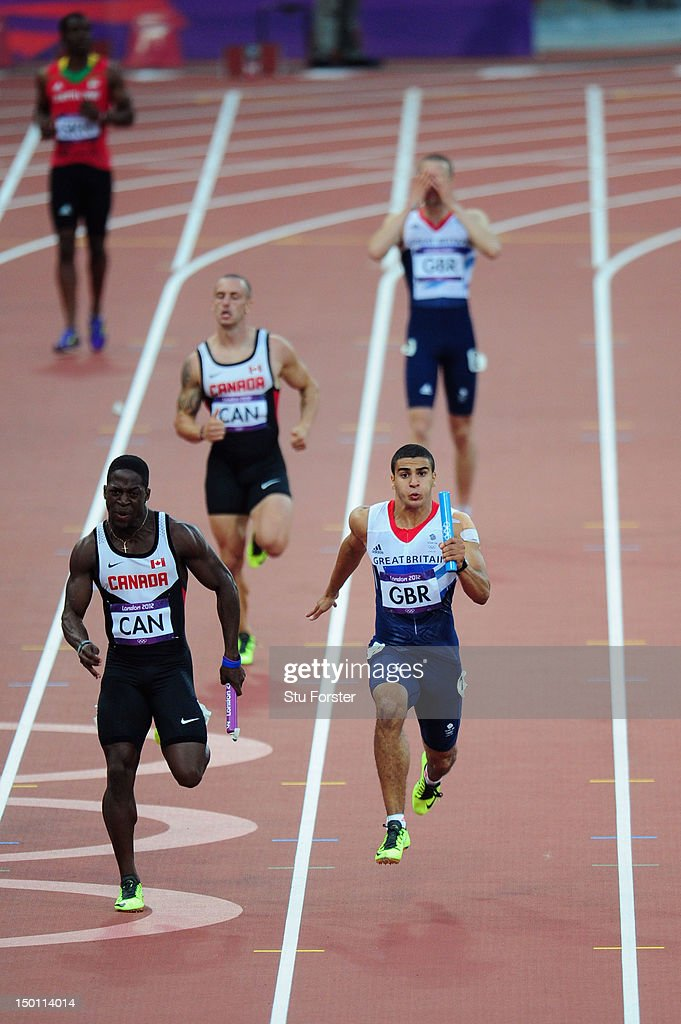 Adam Gemili of Great Britain and Justyn Warner of Canada approach the finish line as Daniel Talbot of Great Britain reacts during the Men's 4 x 100m...