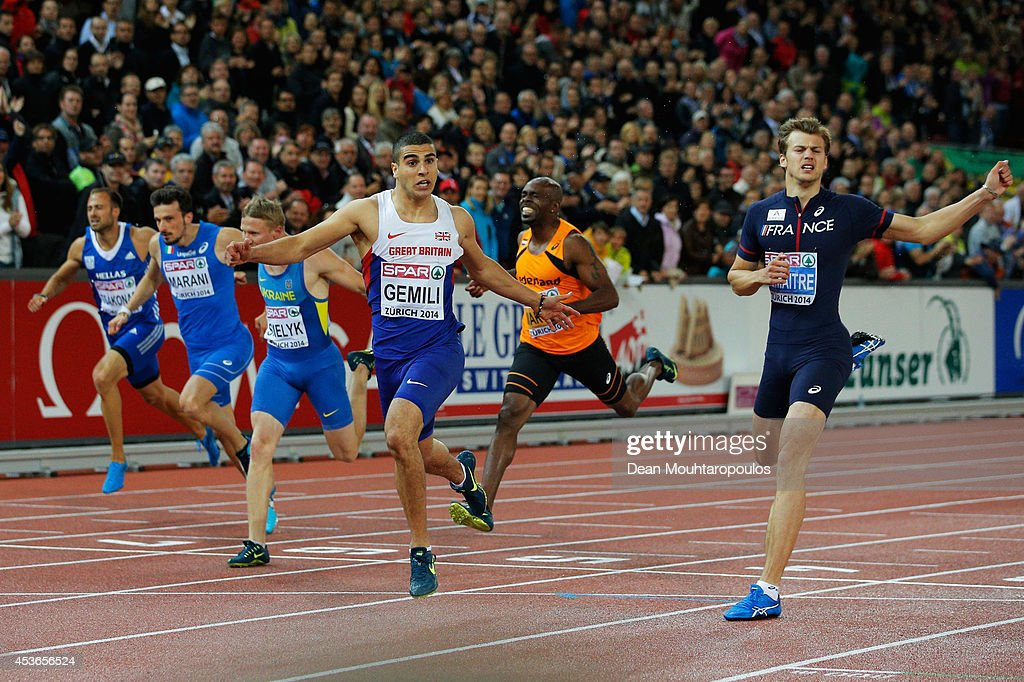 <a gi-track='captionPersonalityLinkClicked' href=/galleries/search?phrase=Adam+Gemili&family=editorial&specificpeople=7091483 ng-click='$event.stopPropagation()'>Adam Gemili</a> of Great Britain and Northern Ireland celebrates winning gold ahead of silver medalist <a gi-track='captionPersonalityLinkClicked' href=/galleries/search?phrase=Christophe+Lemaitre+-+Sprinter&family=editorial&specificpeople=5431868 ng-click='$event.stopPropagation()'>Christophe Lemaitre</a> of France in the Men's 200 metres final during day four of the 22nd European Athletics Championships at Stadium Letzigrund on August 15, 2014 in Zurich, Switzerland.