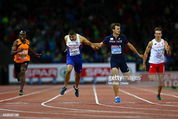 Adam Gemili of Great Britain and Northern Ireland crosses the finish line to win gold ahead of silver medalist Christophe Lemaitre of France in the...