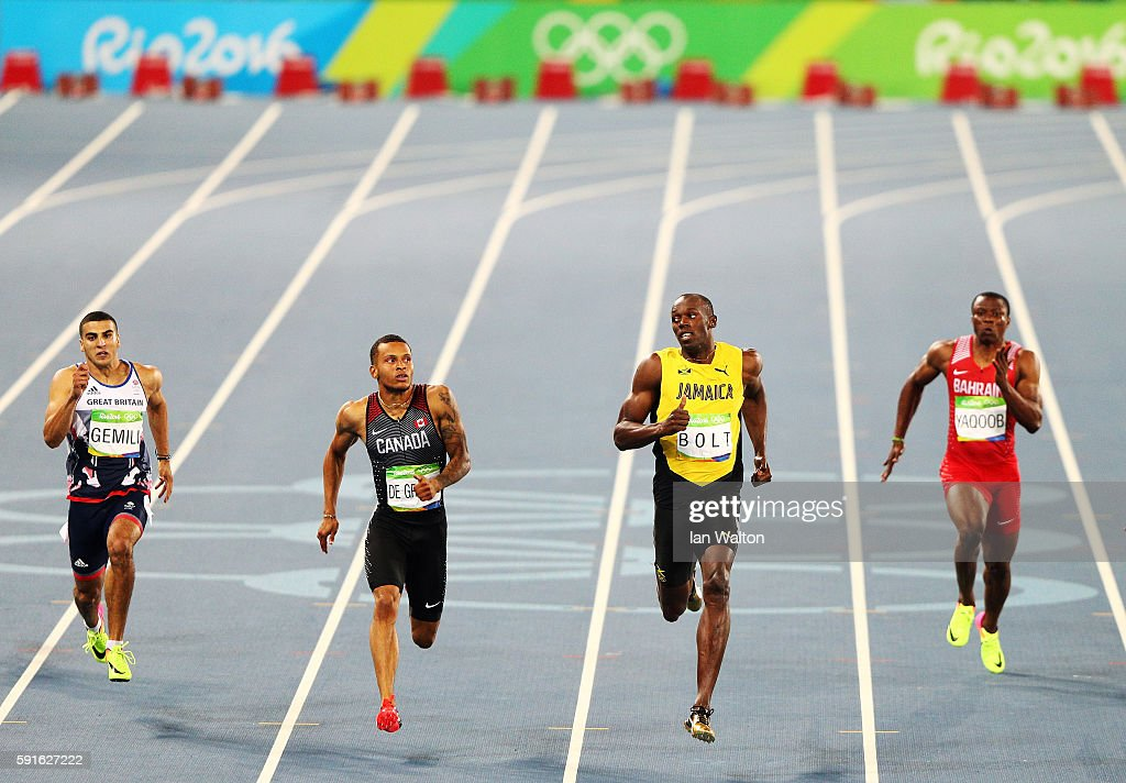 Adam Gemili of Great Britain Andre de Grasse of Canada Usain Bolt of Jamaica and Salem Eid Yaqoob of Bahrain compete in the Men's 200m Semifinals on...
