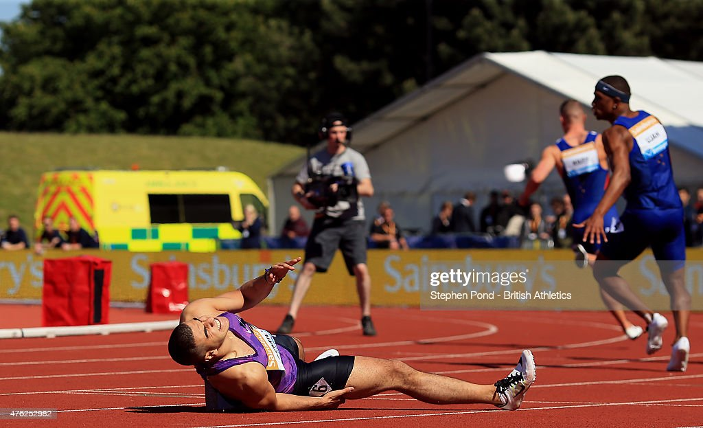 Adam Gemili of Great Britain falls after finishing second in the mens 100m final during the Sainsbury's Birmingham Grand Prix Diamond League event at...