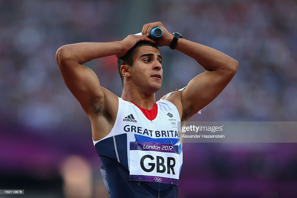 Adam Gemili of Great Britain reacts after the Great Britain team was disqualified during the Men's 4 x 100m Relay Round 1 heats on Day 14 of the...
