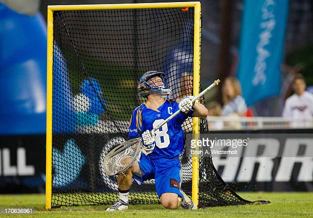 Adam Ghitelman of the Charlotte Hounds can only watch as this shot on goal bounces just under the cross bar during the game against the Boston...