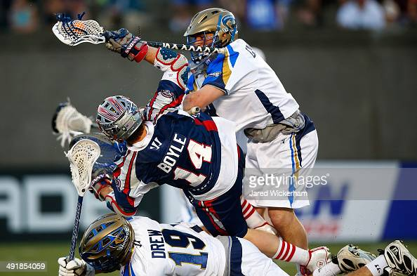 Adam Ghitelman of the Charlotte Hounds hits Ryan Boyle of the Boston Cannons in the second half during the game at Harvard Stadium on May 17 2014 in...