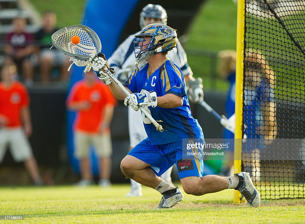 Adam Ghitelman #8 of the Charlotte Hounds makes a save during second half action against the Chesapeake Bayhawks at American Legion Memorial Stadium on June 22, 2013 in Charlotte, North Carolina. The Hounds defeated the Bayhawks 16-15 in overtime.