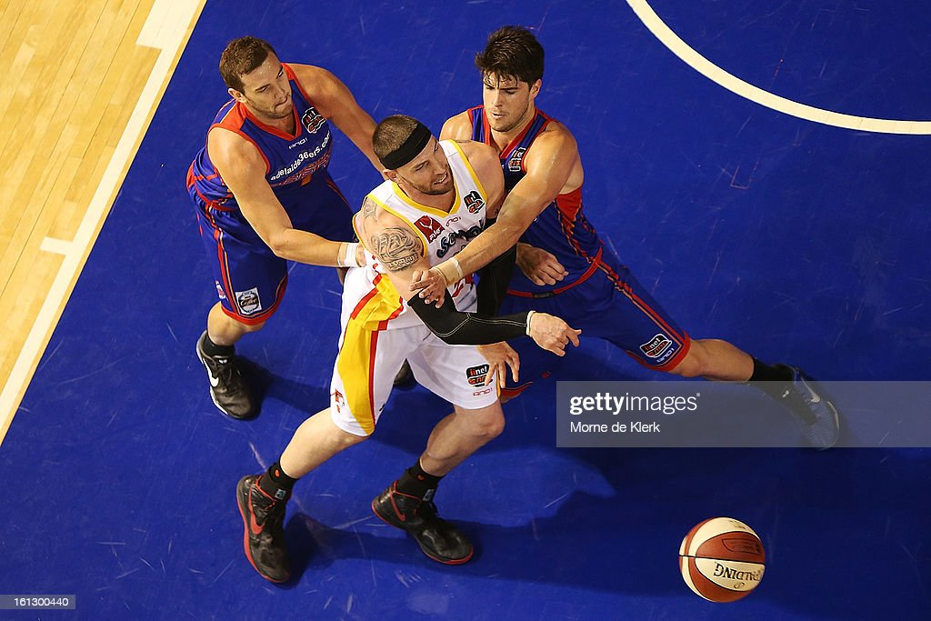 Adam Gibson and Stephen Weigh of the 36ers puts pressure on Seth Scott of the Tigers during the round 18 NBL match between the Adelaide 36ers and the Melbourne Tigers at Adelaide Arena on February 10, 2013 in Adelaide, Australia.