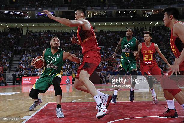 Adam Gibson of Australia drives to the basket against Li Muhao of China during Internationl Basketball Challenge match between the Chinese National...