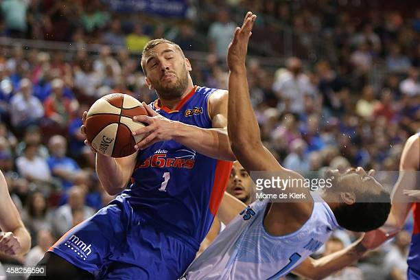 Adam Gibson of the 36ers collides with Mika Vukona of the Breakers during the round four NBL match between the Adelaide 36ers and the New Zealand...