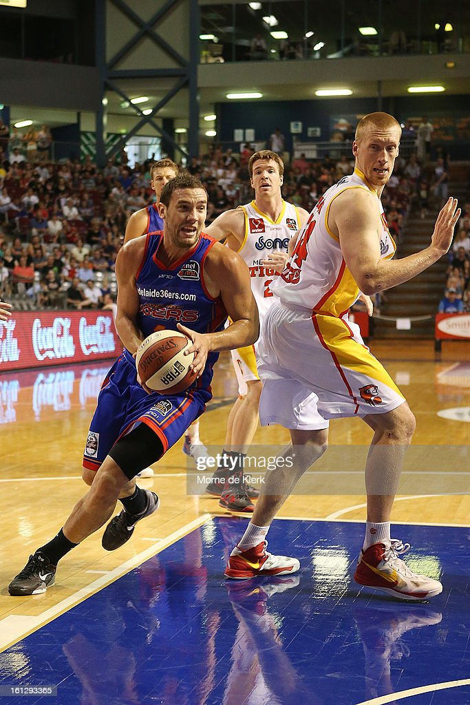 Adam Gibson of the 36ers gets around Adam Ballinger of the Tigers during the round 18 NBL match between the Adelaide 36ers and the Melbourne Tigers at Adelaide Arena on February 10, 2013 in Adelaide, Australia.