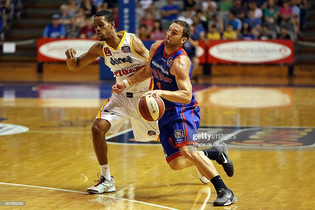 Adam Gibson of the 36ers gets around Bennie Lewis of the Tigers during the round 18 NBL match between the Adelaide 36ers and the Melbourne Tigers at Adelaide Arena on February 10, 2013 in Adelaide, Australia.