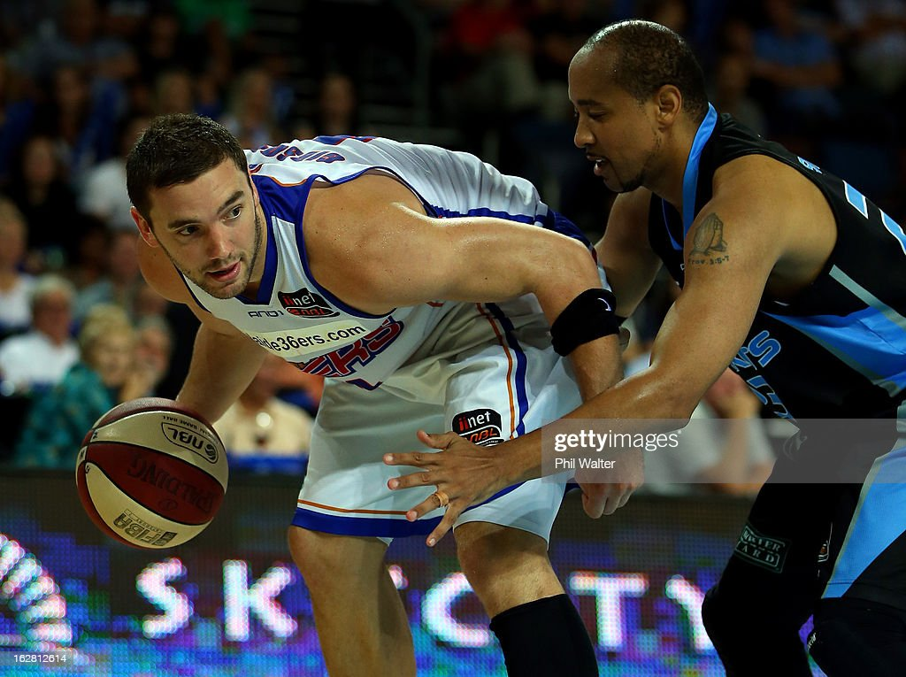 Adam Gibson of the 36ers is put under pressure from <a gi-track='captionPersonalityLinkClicked' href=/galleries/search?phrase=CJ+Bruton&family=editorial&specificpeople=224717 ng-click='$event.stopPropagation()'>CJ Bruton</a> of the Breakers during the round 21 NBL match between the New Zealand Breakers and the Adelaide 36ers at Vector Arena on February 28, 2013 in Auckland, New Zealand.