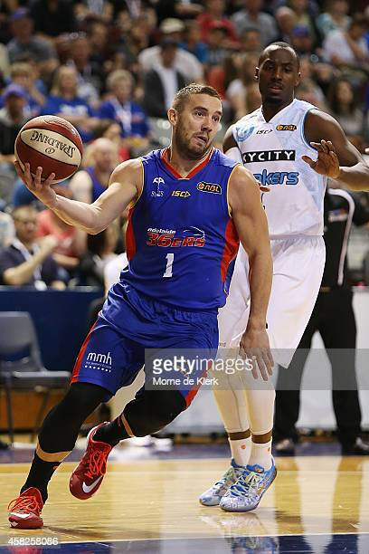 Adam Gibson of the 36ers moves the ball forward during the round four NBL match between the Adelaide 36ers and the New Zealand Breakers at Adelaide...