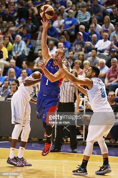 Adam Gibson of the 36ers shoots the ball during the round four NBL match between the Adelaide 36ers and the New Zealand Breakers at Adelaide Arena on...