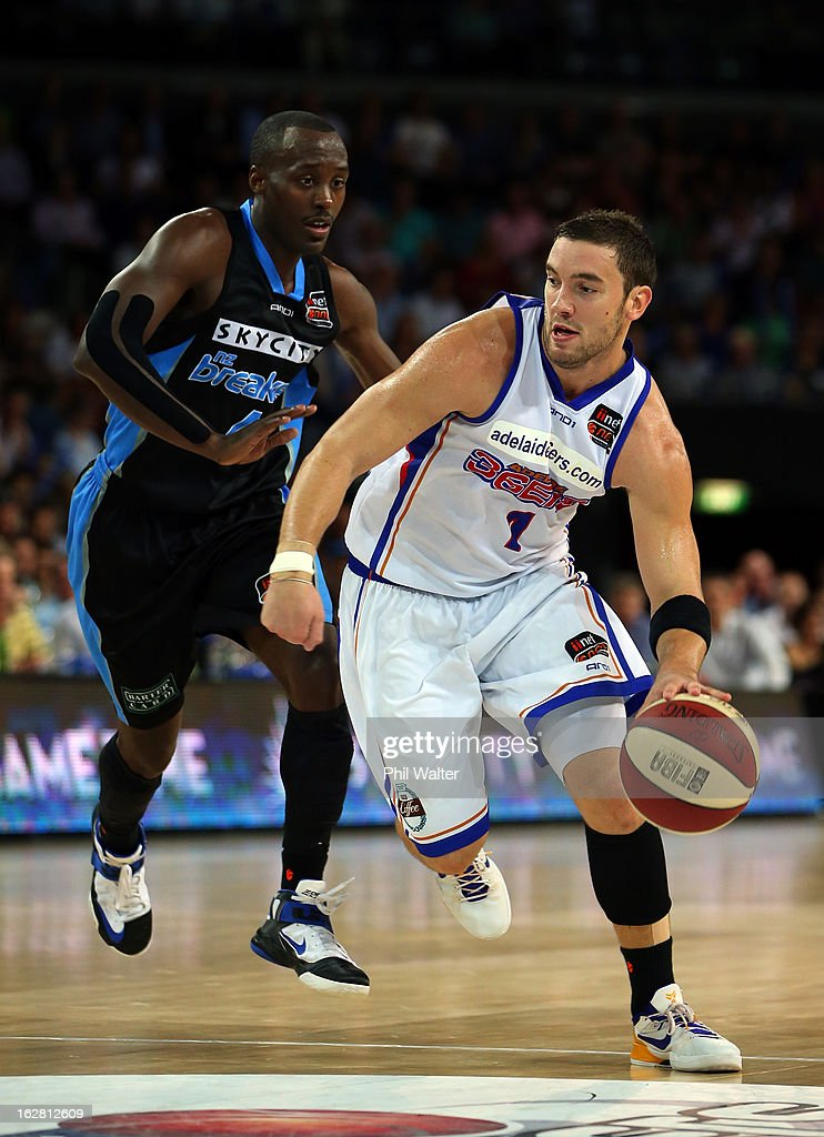 Adam Gibson of the 36ers takes the ball forward under pressure from Cedric Jackson of the Breakers during the round 21 NBL match between the New Zealand Breakers and the Adelaide 36ers at Vector Arena on February 28, 2013 in Auckland, New Zealand.