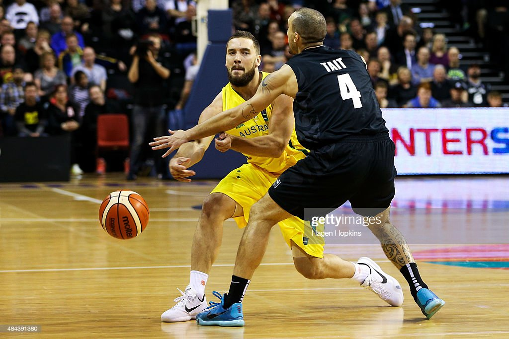 Adam Gibson of the Boomers passes through the defence of Lindsay Tait of the Tall Blacks during the game two match between the New Zealand Tall Blacks and Australian Boomers at at TSB Bank Arena on August 18, 2015 in Wellington, New Zealand.