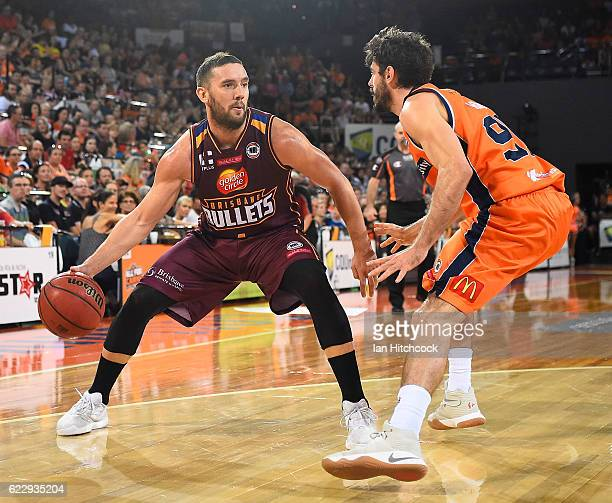 Adam Gibson of the Bullets looks to get past Jarrad Weeks of the Taipans during the round six NBL match between the Cairns Taipans and the Brisbane...