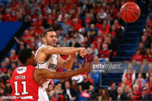 Adam Gibson of the Bullets passes the ball against Bryce Cotton of the Wildcats during the round one NBL match between the Perth Wildcats and the...
