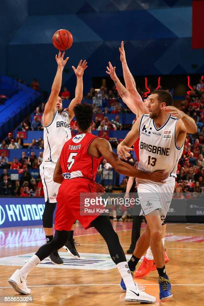 Adam Gibson of the Bullets puts a shot upduring the round one NBL match between the Perth Wildcats and the Brisbane Bullets at Perth Arena on October...