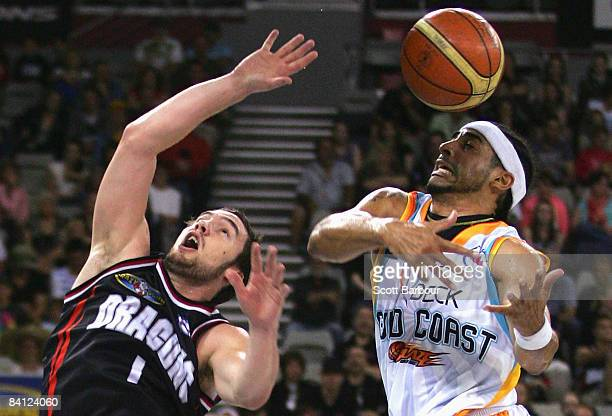 Adam Gibson of the Dragons and Luke Whitehead of the Blaze compete for the ball during the round 15 NBL match between the South Dragons and the Gold...