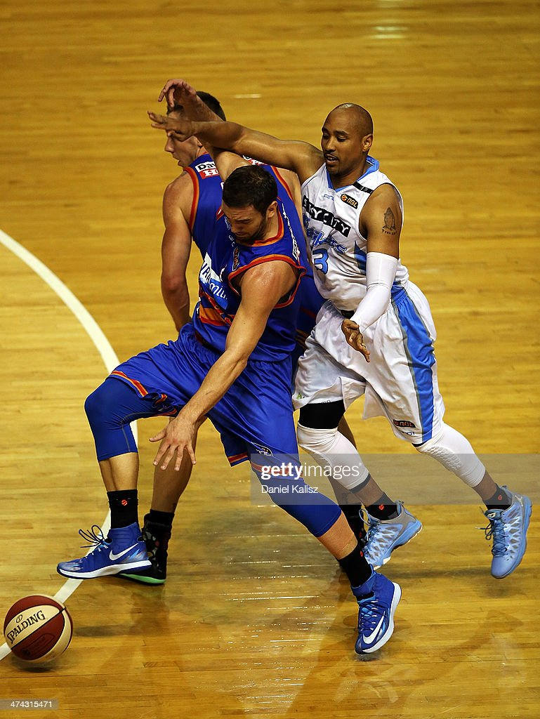 Adam Gibson of the Sixers looks to gain control of the ball over Daryl Corletto of the Breakers during the round 19 NBL match between the Adelaide 36ers and the New Zealand Breakers at Adelaide Arena in February 23, 2014 in Adelaide, Australia.