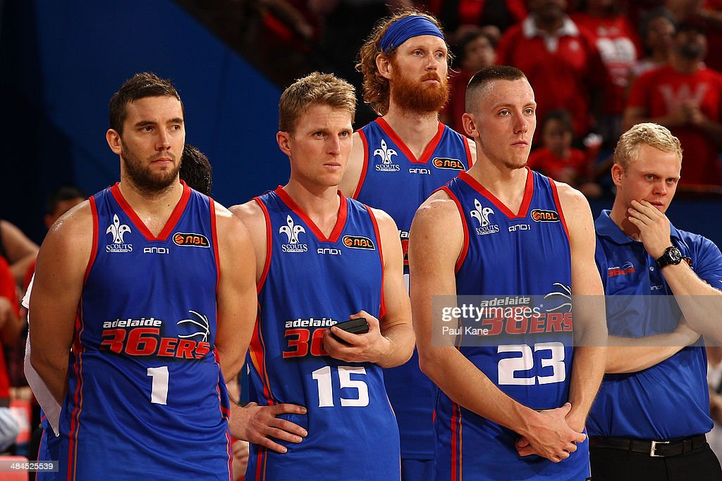 Adam Gibson Rhys Carter Luke Schenscher and Mitchell Creek of the 36ers look on after losing game three and the NBL Grand Final series between the...