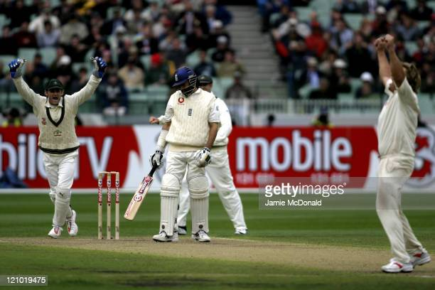 Adam Gilchrist and Shane Warne of Australia celebrate the dismissal of England in the First Innings in Day One of the Fourth Ashes Test at the...