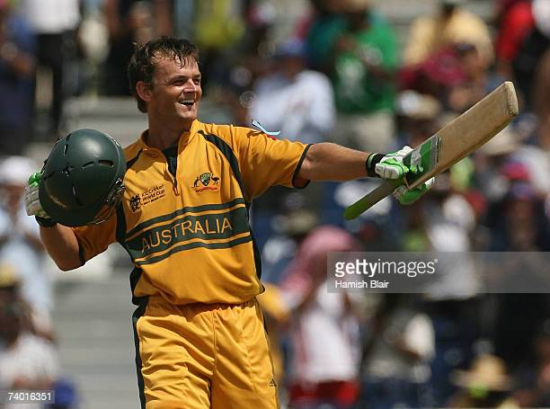 Adam Gilchrist of Australia celebrates his century during the ICC Cricket World Cup Final between Australia and Sri Lanka at the Kensington Oval on...