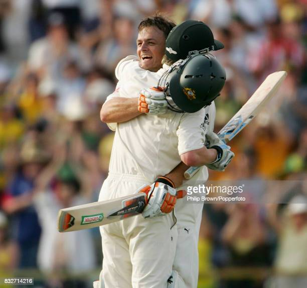 Adam Gilchrist of Australia celebrates reaching his century off only 57 balls with Michael Clarke in the 3rd Test match between Australia and England...