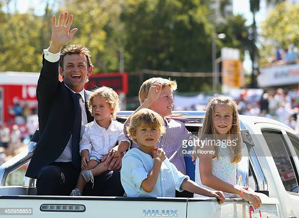 Adam Gilchrist of Australia does a lap of the ground with his family after being inducted into the ICC's Hall of Fame during day one of the Third...