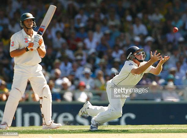 Adam Gilchrist of Australia looks on as Ian Bell of England dives to catch him off the bowling of Monty Panesar of England during day one of the...