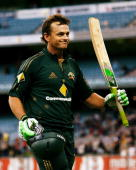Adam Gilchrist of Australia waves goodbye to the crowd after being dismissed and playing his last game on the the MCG during the Commonwealth Bank...