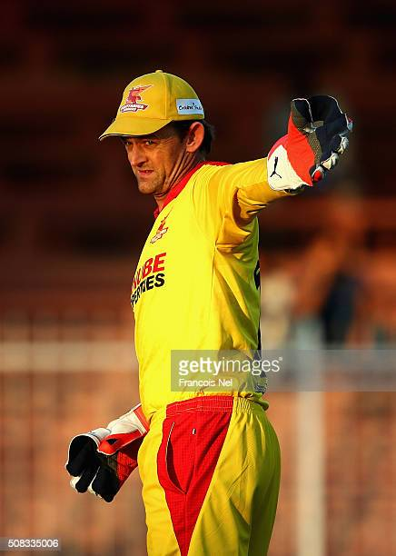 Adam Gilchrist of Sagittarius Strikers looks on during the Oxigen Masters Champions League match between Libra Legends and Sagittarius Strikers at...