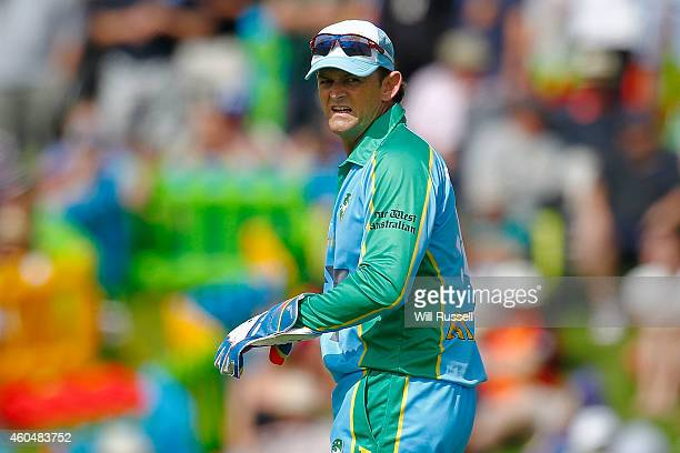 Adam Gilchrist of the Legends XI looks on during the Twenty20 match between the Perth Scorchers and Australian Legends at Aquinas College on December...