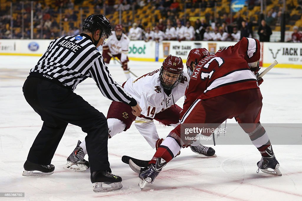 Adam Gilmour of the Boston College Eagles faces off against Sean Malone of the Harvard Crimson during the 2015 Beanpot Tournament consolation game at...