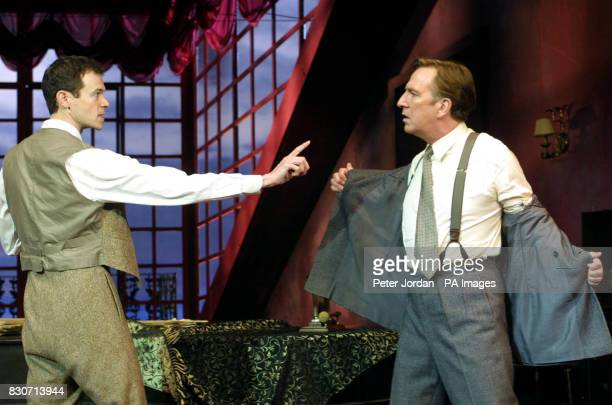 Adam Godley as 'Victor' points his finger in anger at Alan Rickman as 'Eiyot' at a photo call for Howard Davies's production of Noel Coward's...