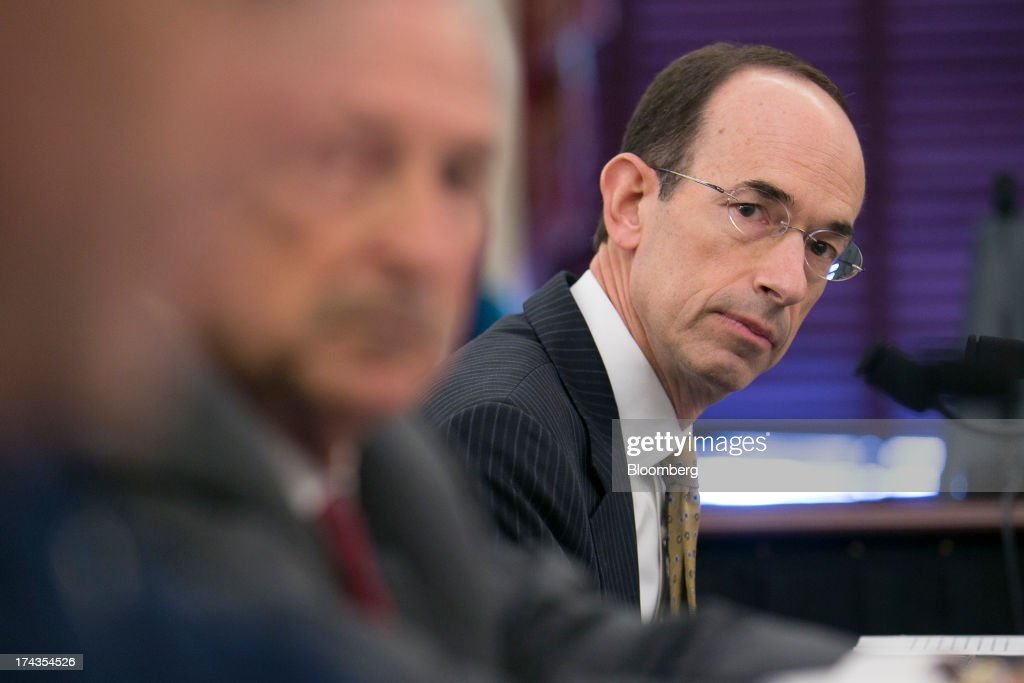 Adam Goldstein, president and chief executive officer of Royal Caribbean Cruises Ltd.'s Royal Caribbean International, right, listens during a Senate Commerce, Science, and Transportation hearing in Washington, D.C., U.S., on Wednesday, July 24, 2013. Carnival Corp., Royal Caribbean Ltd. and Norwegian Cruise Line Holdings Ltd., the target of proposed legislation after high profile mishaps at sea, will voluntarily publish more data about crimes on their cruises. Photographer: Andrew Harrer/Bloomberg via Getty Images