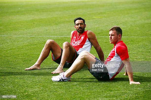Adam Goodes and Ben McGlynn of the Swans stretch during a Sydney Swans AFL recovery session at the Sydney Cricket Ground on September 20 2014 in...