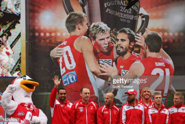 Adam Goodes and coach John Longmire wave to the crowd with their Swans team mates during the 2012 AFL Grand Final Parade on September 28 2012 in...