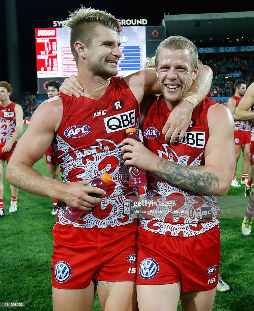 Adam Goodes, Kieren Jack and <a gi-track='captionPersonalityLinkClicked' href=/galleries/search?phrase=Michael+O%27Loughlin&family=editorial&specificpeople=215115 ng-click='$event.stopPropagation()'>Michael O'Loughlin</a> walk with the Marn Grook Trophy during the 2016 AFL Round 10 match between the Sydney Swans and the North Melbourne Kangaroos at the Sydney Cricket Ground on May 27, 2016 in Sydney, Australia.