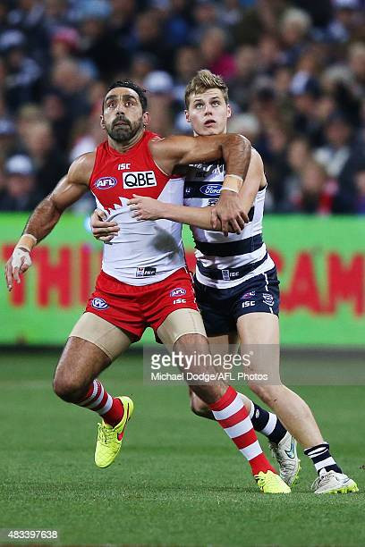 Adam Goodes of the Swans and Cats competes for the ball against Jake Kolodjashnij during the round 19 AFL match between the Geelong Cats and the...